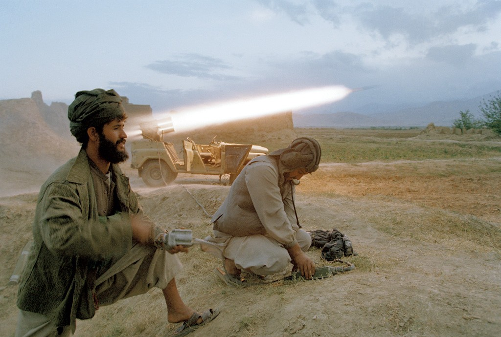 Taliban soldiers fire a rocket at retreating forces of the Northern Alliance army north of Kabul. - COURTESY OF ROBERT NICKELSBERG