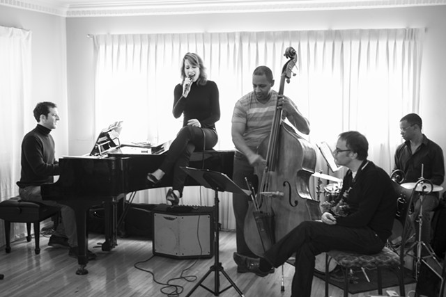 The chanteuse with her band - COURTESY OF MOLLY RINGWALD