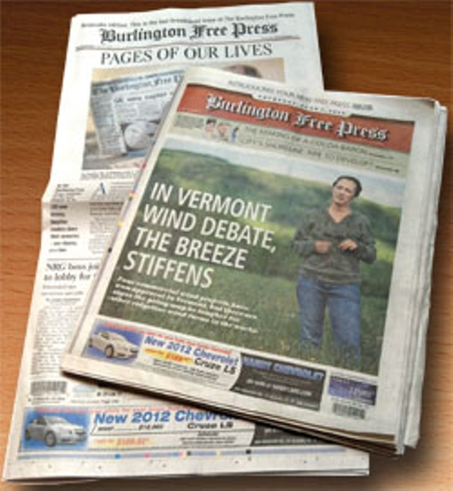 The first Free Press edition in the new format (front) and the last edition in the old format (rear)