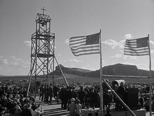 The integration of the natural landscape, the church's architecture, and two flags. - TWENTIETH CENTURY FOX PICTURES