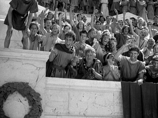 Though cheering for the actual spilling of blood, these spectators at a Pompeiian gladiator contest are generally more civilized than modern hockey fans. - WARNER BROS. PICTURES