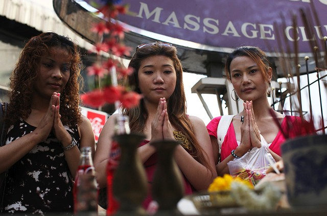 Three prostitutes pray before their shift. - LOTUS FILMS