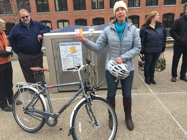 Local Motion executive director Emily Boedecker stands outside Champlain Mill during a press conference announcing the installation of bike lockers in Winooski and Burlington. - MARK DAVIS