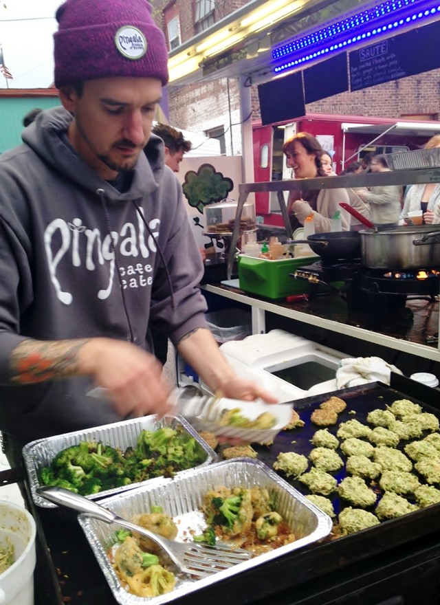 Trevor Sullivan, owner of Pingala Café, making broccoli-potato latkes - STACEY BRANDT