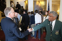 Former governor Jim Douglas shakes Sargent-at-Arms Francis Brooks' hand at the Statehouse last month. - FILE: PAUL HEINTZ