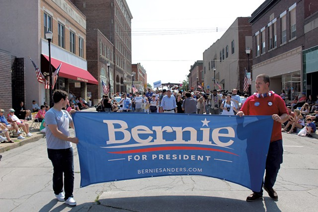 Sanders marching in a Creston, - Iowa, Independence Day parade - PAUL HEINTZ