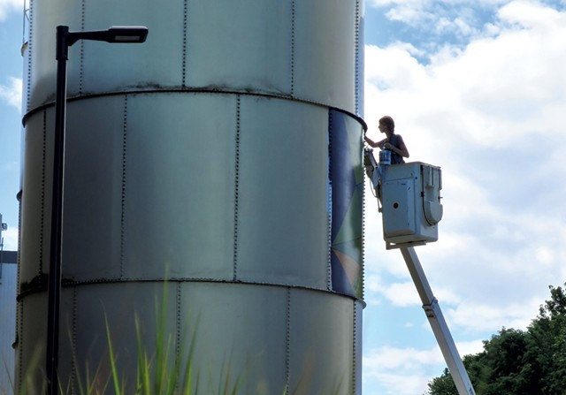 Mary Lacy painting the Dealer.com silos - MATTHEW THORSEN