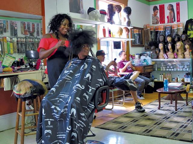 Mistre Newton gets her hair done at Burlington's Diversity Hair Salon. - MATTHEW THORSEN