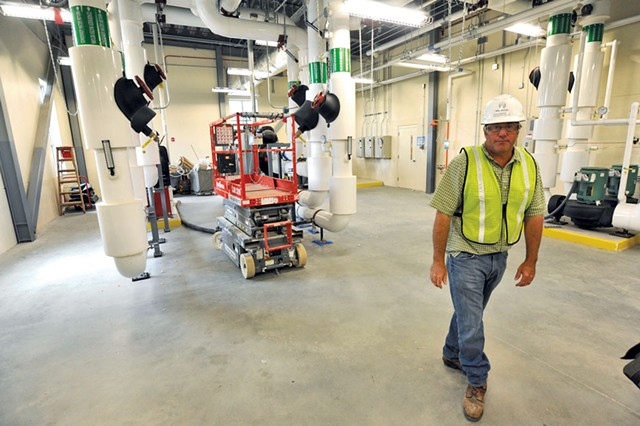 Mike Stevens in the new heating and cooling plant of the new Waterbury complex - JEB WALLACE-BRODEUR