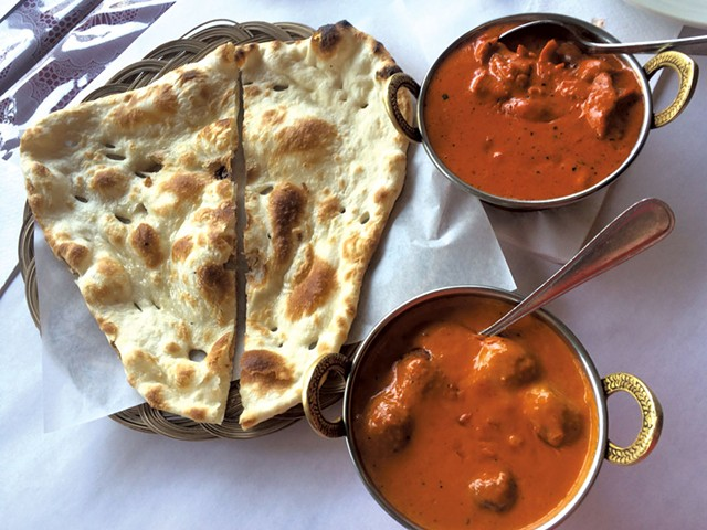Butter chicken and malai kofta with naan at India's Oven - ALICE LEVITT