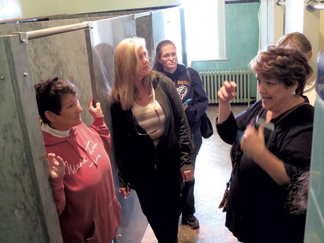 Debi Gevry-Ellsworth (left) and Sheila Billow Cardwell (center) listening to Valerie Clairmont Smith - MATTHEW THORSEN