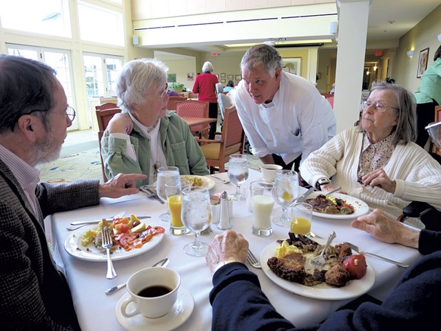 Bill Koucky visiting with residents in the dining room - MATTHEW THORSEN