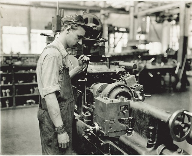 Factory worker operating a lathe - COURTESY OF AMERICAN PRECISION MUSEUM