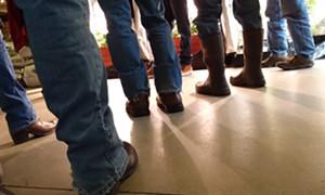 Feet of participants at a Green State Gardener class - ELIZABETH M. SEYLER