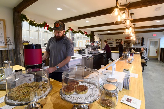 Max Duquette working the counter at the new Vermont Artisan Coffee & Tea - JEB WALLACE-BRODEUR