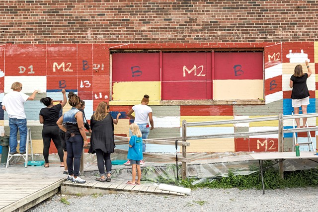 King Street Center and community volunteers painting the Moran Plant with Clark Derbes in 2015 - OLIVER PARINI