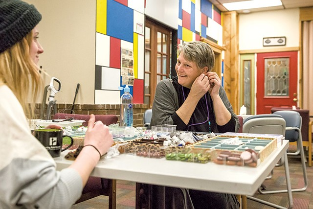 Sara Glasgow (right) making jewelry with a guest at the Turning Point Center - OLIVER PARINI