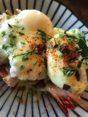 Eggs Benedict at Misery Loves Co. - SUZANNE M. PODHAIZER