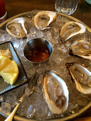 New Year's Day oysters at Misery Loves Co. - SUZANNE M. PODHAIZER