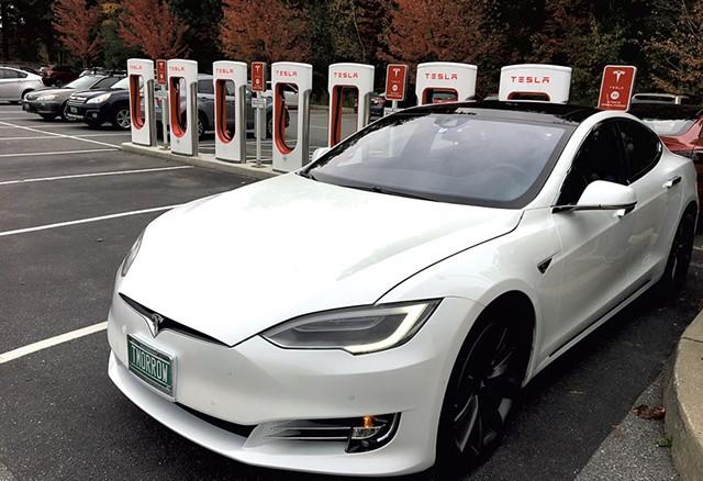 Tesla Supercharger station at Healthy Living Market & Café - DAN BOLLES