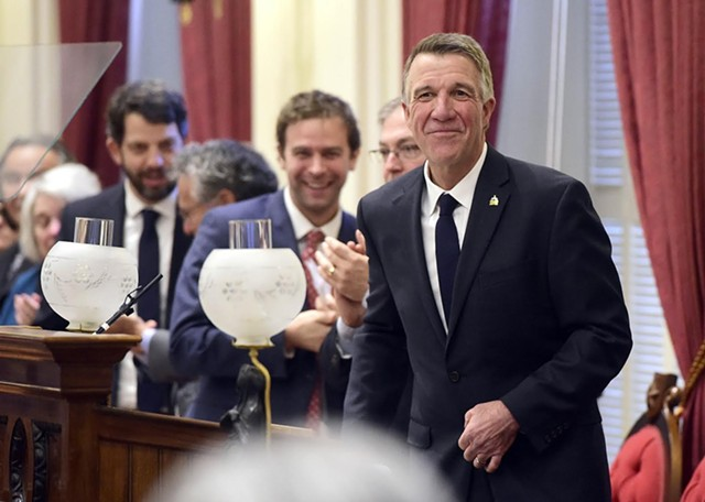Gov. Phil Scott surrounded by lawmakers at his State of the State address Thursday - JEB WALLACE-BRODEUR