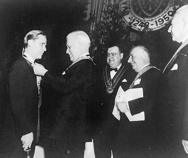 Spitler's father (left) being inducted to La Confrérie de la Chaîne des Rôtisseurs by her grandfather in New York City, circa 1960 - COURTESY OF CHAÎNE DES RÔTISSEURS