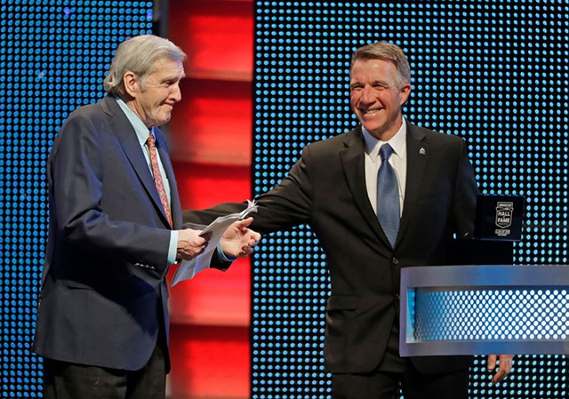 Gov. Phil Scott (right) inducts Ken Squier into NASCAR's Hall of Fame in Charlotte, N.C. - AP PHOTO/CHUCK BURTON