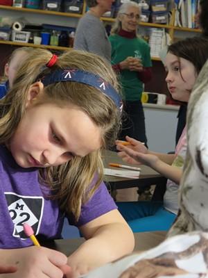 Gretchen Toy writing a letter to Last Resort Farm - MATTHEW THORSEN