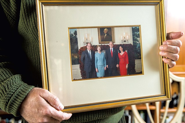 A photo of (left to right) Skip Vallee, Laura Bush, president George W. Bush and Denise Vallee - JAMES BUCK