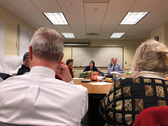 Senate Democrats meeting in the basement of a state office building. - ALICIA FREESE