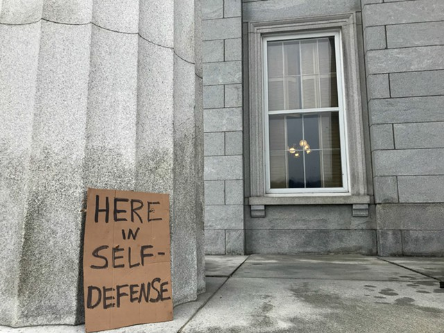A gun control demonstrator left a sign outside the window of the Senate Judiciary Committee meeting room. - TAYLOR DOBBS