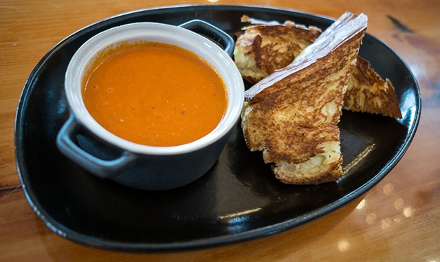 Tomato soup and grilled cheese sandwich at the Mid-Mountain Cabin at the Hermitage Club in Wilmington - ZACHARY P. STEPHENS