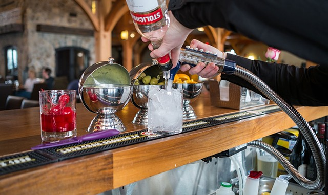 Mixing a vodka tonic at the Hermitage Club in Wilmington - ZACHARY P. STEPHENS