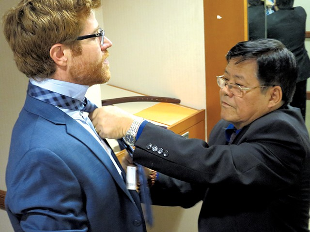 Sonam Chophel helping Dan Bolles with a tie - MATTHEW THORSEN