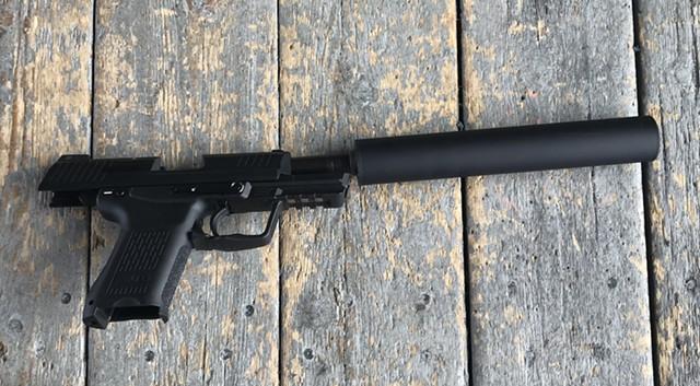Suppressed Heckler & Koch .45 caliber pistol - TAYLOR DOBBS