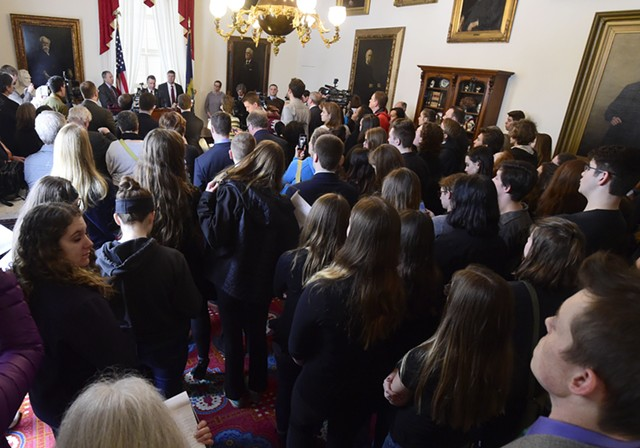 Students watch Gov. Phil Scott outline new gun-control proposals Thursday at the Statehouse. - JEB WALLACE-BRODEUR