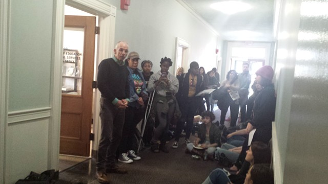 Thomas Scott, dean of the College of Education and Social Services, addressing students outside of his office - KYMELYA SARI