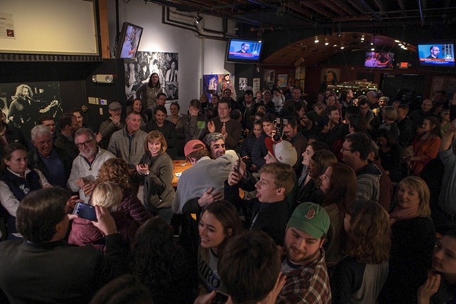 Weinberger hugs a supporter (center, red hat) at Nectar's. - LUKE AWTRY
