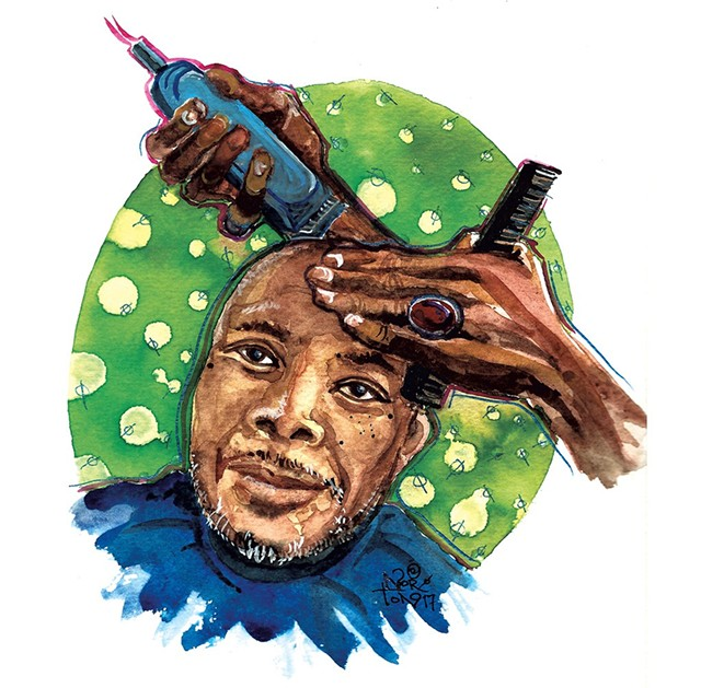 Reuben Jackson, receiving a haircut from Amir Yasin - SUSAN NORTON