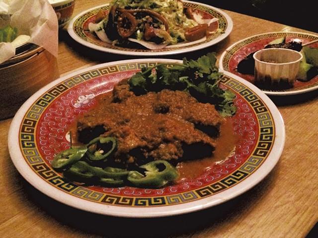 Smoked octopus salad, beef satay and lamb kamouraska korma at Satay Brothers - MOLLY ZAPP