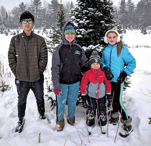 """Left to right: Weizhuo """"Leo"""" Kong with the children in his host family, Abbie Fountain, Stewart Lemnah and Madison Fountain - COURTESY OF MELANIE LEMNAH"""
