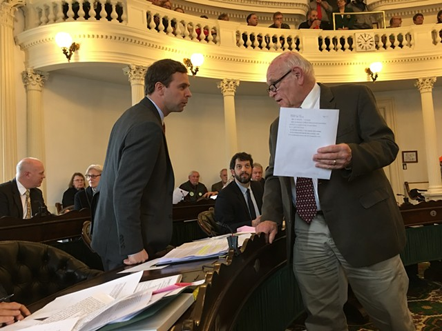 Senate President Pro Tempore Tim Ashe consulting with Sen. Dick Sears during a recess in the S.55 debate - JOHN WALTERS