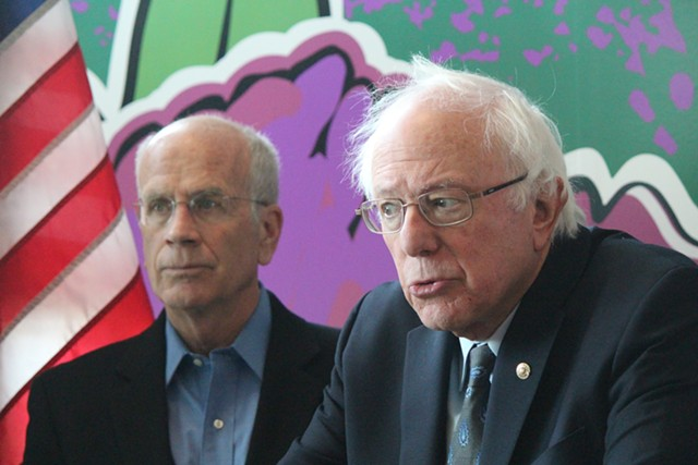 Congressman Peter Welch and Sen. Bernie Sanders at a press conference in January 2018 at Burlington International Airport - PAUL HEINTZ