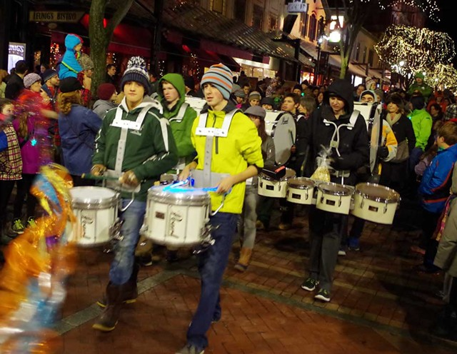 Drum Corps parading on Church Street during First Night Burlington - COURTESY OF STEVE MEASE