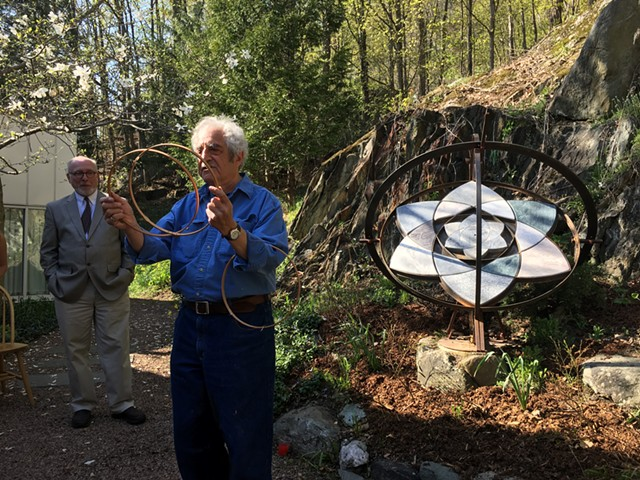 """Paul Calter, right, with his sculpture """"Trillium"""" as  state curator David Schütz looks on. - JOHN WALTERS"""