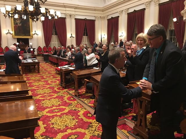 After his adjournment speech to the House, Gov. Phil Scott pauses for a handshake with House Minority Leader Don Turner. - JOHN WALTERS