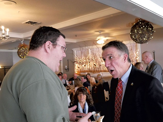 Brien Lemois confronting Gov. Phil Scott at the East Side Restaurant & Pub in Newport - COURTESY OF NEWPORT DISPATCH