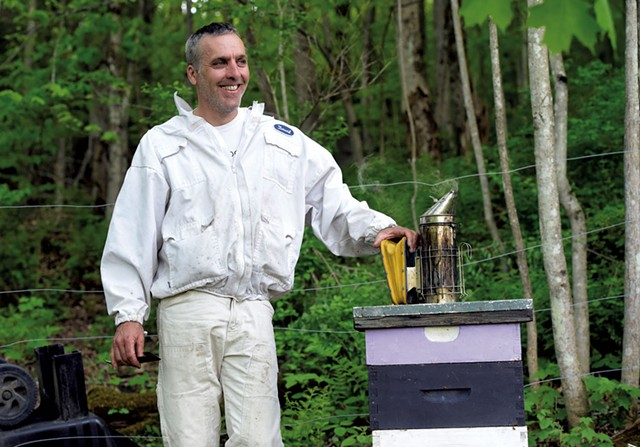 David Tremblay with a hive in Montpelier - JEB WALLACE-BRODEUR