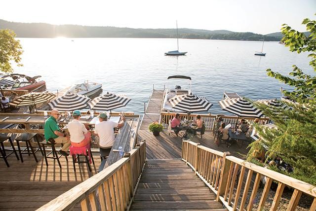 Outdoor dining at Lake House Pub & Grill - CALEB KENNA