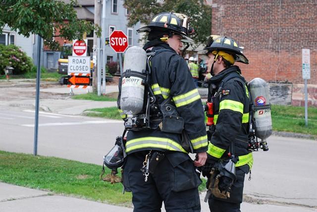 Firefighters on scene ushered residents across the street. - SARA TABIN